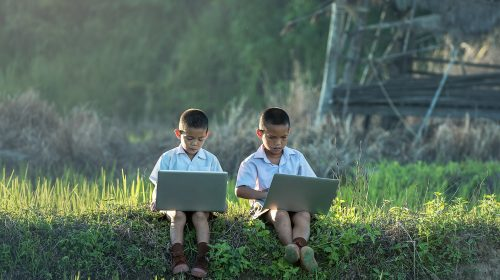 Children in indonesia studying with laptops